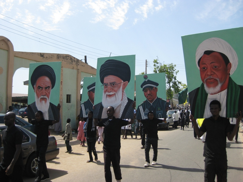 IMN members hold posters of Khomeini, Khamenei, and Zakzaky during 2015 Quds Day rally (Source: Islamic Invitation Turkey)