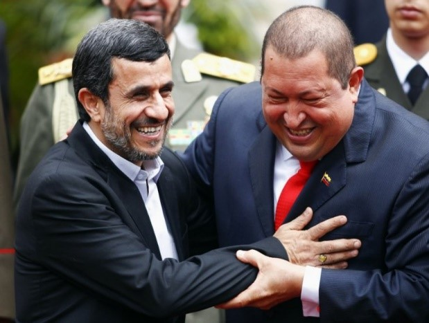 Iran's President Mahmoud Ahmadinejad is welcomed by Venezuela's President Hugo Chavez at Miraflores Palace in Caracas in 2012.(Reuters)