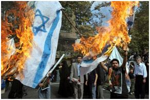 Burning Israeli flags at a Quds Day rally in Tehran