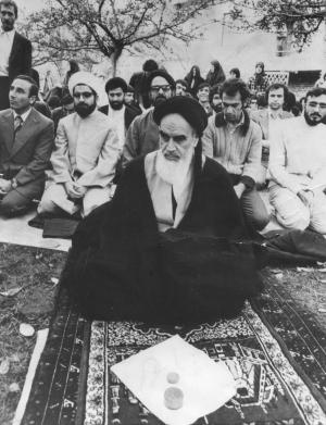 Hassan Rouhani (2nd from the left) praying with Ayatollah Khomeini and his revolutionary followers in Paris in 1978.