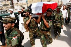 Funeral in Baghdad for an Iraqi Shi'a who was killed in Syria fighting alongside the forces of Bashar al-Assad.